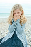 Pretty girl at the autumn beach Stock Image