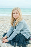 Pretty girl at the autumn beach Royalty Free Stock Photography