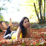 Pretty girl in the autumn forest Royalty Free Stock Photo