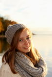 Pretty girl in autumn by the lake Stock Photos
