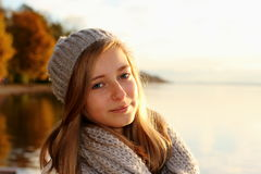 Pretty girl in autumn by the lake Royalty Free Stock Image