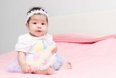Pretty girl baby sit on pink blanket. Pretty cute girl baby sit on pink blanket Stock Photography