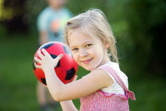 Pretty girl with the ball Royalty Free Stock Photos