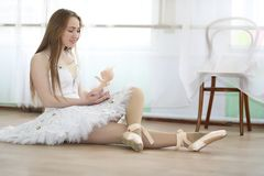 Pretty girl ballet dancer practicing stock images