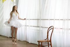Pretty girl ballet dancer practicing. Indoor in room stock images