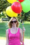 Pretty Girl and Balloons Royalty Free Stock Photo