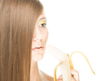 Pretty girl with banana isolated on white. Stock Photos