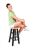 Pretty girl on a bar chair. Royalty Free Stock Photos