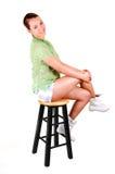 Pretty girl on a bar chair. Royalty Free Stock Photos