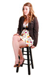 Pretty girl on a bar chair. Royalty Free Stock Images