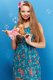 Pretty girl with barbie Stock Photography