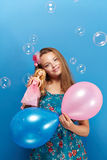 Pretty girl with barbie Royalty Free Stock Photography