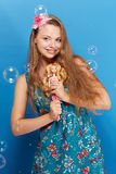Pretty girl with barbie Royalty Free Stock Photo