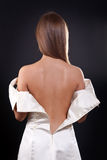 Pretty girl with bare back in the studio Royalty Free Stock Photos