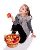 Pretty girl  with basket of red apples Stock Photos