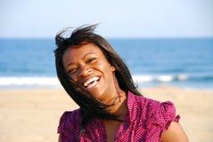 Pretty Girl on beach. Pretty young girl wearing purple portrait stock photos