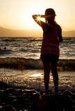 A pretty girl at the beach at sunset  evening Royalty Free Stock Photo