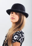 Pretty girl in a beautiful dress and a hat Royalty Free Stock Photography