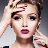 Pretty girl with beautiful face bright make-up and gold jewelry stock photos