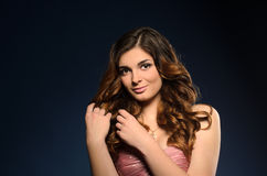 Pretty girl with beautiful hair and professional makeup royalty free stock photos