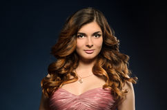 Pretty girl with beautiful hair and professional makeup Stock Photos