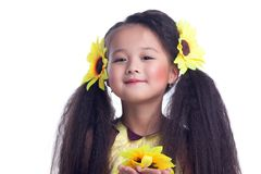 Pretty girl with beautiful hair and sunflowers. Portrait of pretty asian little girl. Isolated on white royalty free stock images