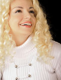 Pretty girl. Beautiful young woman with curly blond hair, smiling royalty free stock photography
