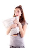 Pretty girl in bedclothes hold pillow and make surprise face Royalty Free Stock Images