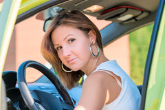 Pretty girl behind the wheel of a car Royalty Free Stock Photos