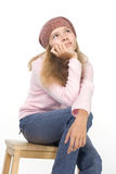 Pretty girl in a beret. Beautiful girl in a beret sits on a chair Stock Images