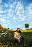 Pretty girl and bicycle Royalty Free Stock Photos