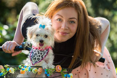 Pretty girl with bicycle and Maltese dog. Young pretty girl with bicycle and Maltese dog Stock Images