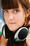 Pretty girl with big headphones. Pretty young girl with big headphones listening to music Stock Photography