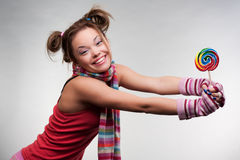 Pretty girl with big lollipop Stock Images