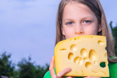 Pretty girl with a big piece of cheese Stock Image