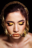 Pretty girl with bijouterie and fashion makeup Stock Photography