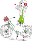 Pretty girl and bike Stock Images
