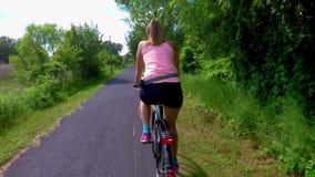 Pretty girl biking on Balaton bike trail near the Lake Balaton of Hungary stock footage