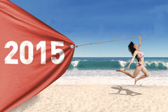 Pretty girl in bikini with banner new year Stock Images