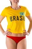 Pretty girl in bikini and brasil tshirt Royalty Free Stock Photography