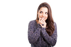 Pretty girl biting her nails Stock Photo