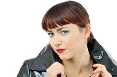 Pretty girl in black cloack Stock Image