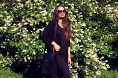 Pretty girl in black clothes outdoors Royalty Free Stock Image