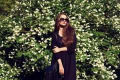 Pretty girl in black clothes outdoors Royalty Free Stock Photography