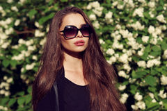 Pretty girl in black clothes outdoors Royalty Free Stock Images
