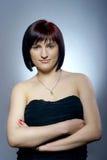 Pretty girl in black dress Royalty Free Stock Photos