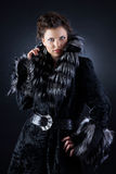 Pretty girl in a black fur coat Royalty Free Stock Photo