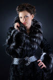 Pretty girl in a black fur coat Royalty Free Stock Images