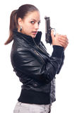 Pretty girl in black leather jacket holding gun Stock Image