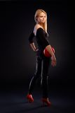Pretty girl in black with red ball Royalty Free Stock Image